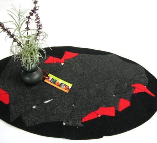 Eco design table topper in upcycled wool felt offcuts in charcoal black and red