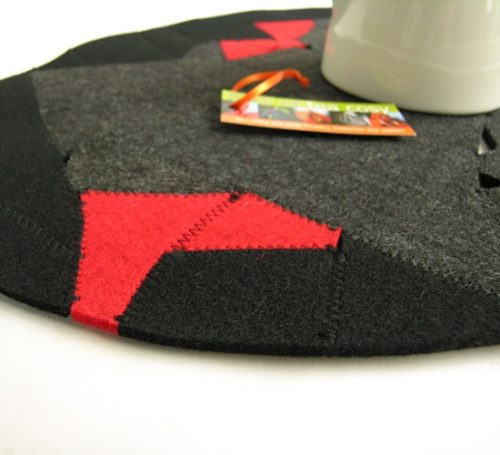 Wool felt upcycled into elegant table protectors in charcola, black and red
