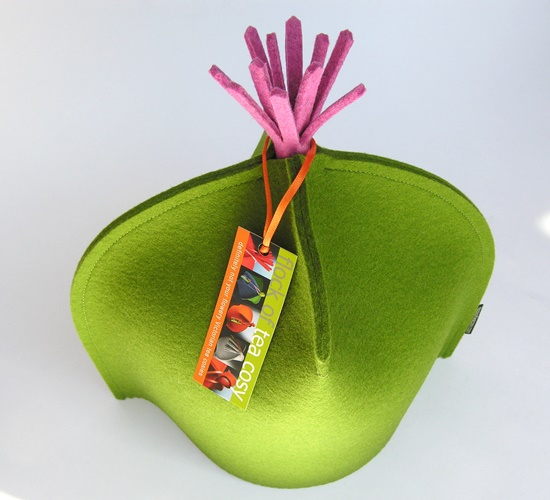Modern tea cozy with pink tassel