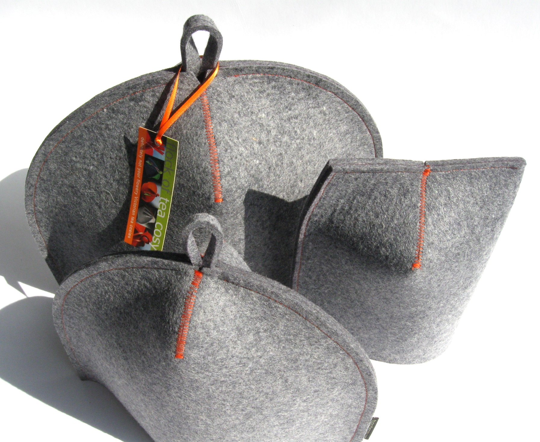 Teaware trio in industrial wool felt by Flock of Tea Cosy