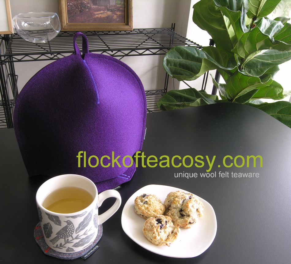 Afternoon tea -- scones, Darjeeling, a modern Royal Purple tea cosy and matching teapot trivet.