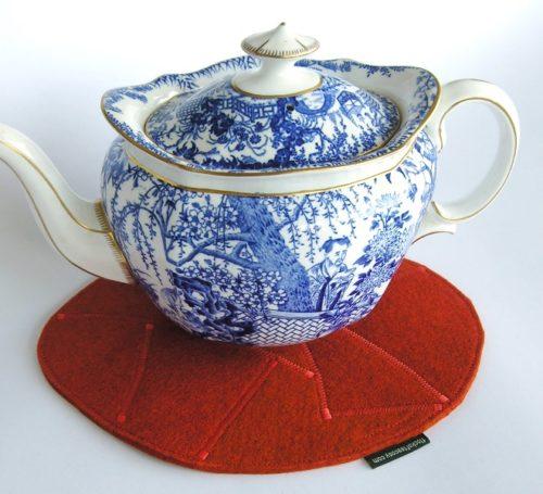 Teapot trivet in burnt orange wool felt