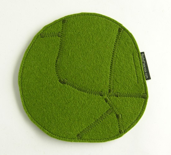 Wool felt trivet in Moss Green, unique styling, eco concious.