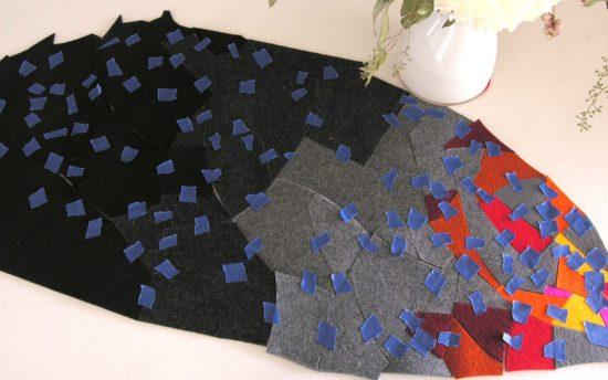 Table topper in progress from a multitude of wool felt scraps