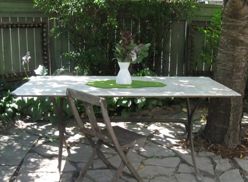 Moss Green wool felt table topper on outdoor marble table