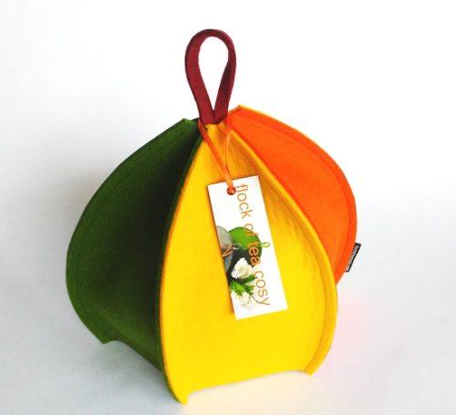 Multicoloured wool felt tea cosy in yellow orange and green modern design