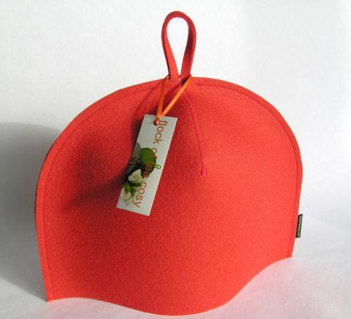 Modern tea cozy in wool felt in Coral Orange