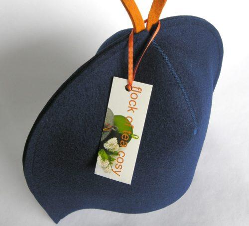 Modern design tea cosy in indigo blue wool felt by flock of tea cosy