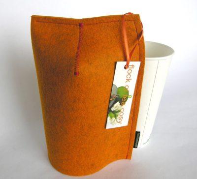 Modern minimalist mug cosy in orange wool felt with 20oz takeout cup
