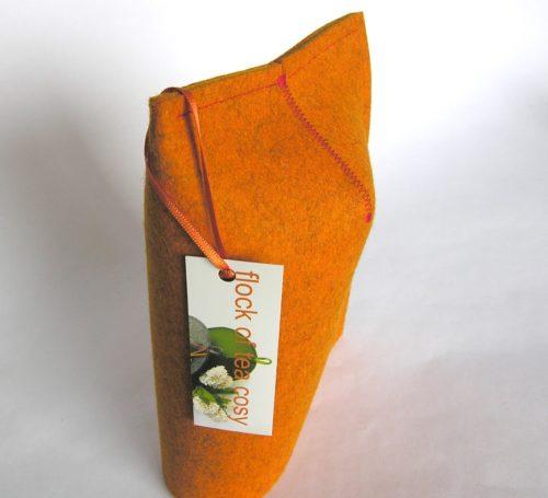 Simple clean design for mug warmer in Tangerine wool felt