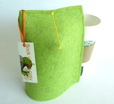 Mug cosy or warmer for 20oz takeout papercup or tall mug made in pistachio green wool felt with yellow stitching by flock of tea cosy