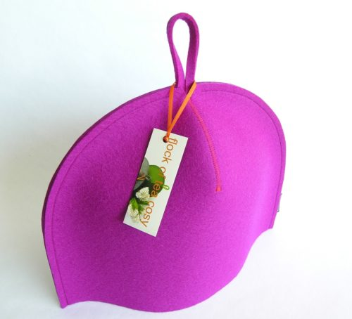 Modern minimalist tea cosy in thick magenta wool felt with hang tab by flock of tea cosy gift for modern home