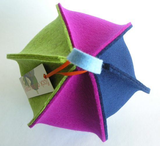 Modern small tea cosy in thick wool felt six paneled expandable magenta indigo blue pistachio green by flock of tea cosy