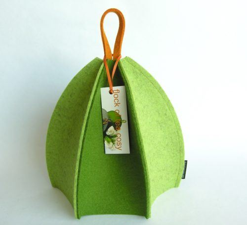 Small modern minimalist tea cozy in thick European wool felt in moss gree and pistachio green in alternating panels expandable by flock of tea cosy