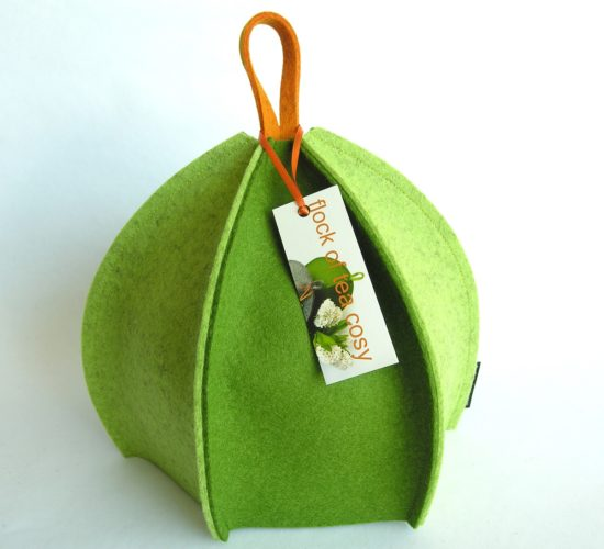 Modern tea cozy expandaable wool felt in moss green and pistachio green by flock of tea cosy